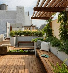 Lush greenery fills this surprisingly expansive rooftop by Pulltab A+D in the East Village of Manhattan. The space boasts separate seating and entertaining areas, plus an outdoor shower.