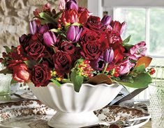 Thanksgiving ~ In lieu of typical autumn blooms, display roses and tulips — but arrange them in a classic ironstone compote. Abundance, the season's theme, calls for a table brimming with beautiful color.