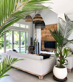 This living room has something exotic . The plants lamps and wooden wall make y… This living room has something exotic . The plants lamps and wooden wall make y… Febs Rustic Living Room Furniture, Home Living Room, Living Room Designs, Living Room Decor, Living Spaces, Plants In Living Room, Bali Style Home, Bali Decor, Bohemian Decor