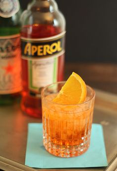 Recipe: Aperol Spritz - 1.5 oz Aperol, 3 oz Prosecco, Club Soda, Orange Slice for garnish... Place ice cubes in a low ball glass. Add Aperol, then Prosecco, and top with soda. Gently mix and garnish with an orange slice.