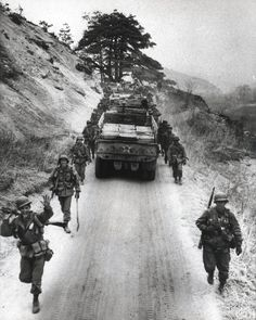 "5th Marine Supply trucks move North to relieve Army Elements moving to the rear, on 12 April"" 1951."