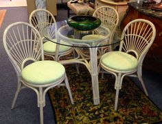 Rattan Dinette set. Off-white. 4 chairs and 36 inch glass top table.SOLD
