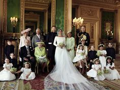 And even the formal wedding photo with the Queen, Prince Philip, William, Charles and Meghan's mother Doria has an informal warm feel