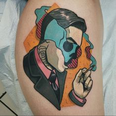 This tattoo uses amazing color to make an abstract portrait which a skull being shown underneath the smoke. A really neat design! #TattooIdeasDibujos