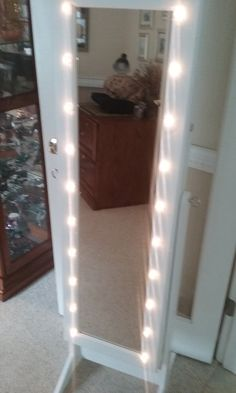 WHITE MIRRORED JEWELRY CABINET ~ What ~ Framed by painted white wood, this oblong dressing mirror on a sturdy stand has a large hidden jewelry cabinet that comes with a key and lock for security. A…