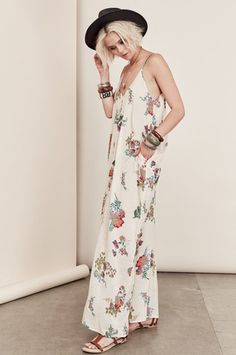 Bohemian Dresses & festival street style: Sleeveless ivory white floral print Maxi dress with pockets. Front view