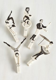 A set of clothespins masquerading as a circus troupe.