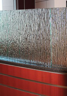 """Sarah Bush Lincoln Hospital - Matoon, IL  Glass Description:  Waiting Room Partition  1/2"""" Tempered Kiln-Fired Glass  Texture: MD230 Neo Strata  Curved Glass"""