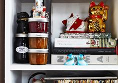 Favorite cookbooks and vinyl share shelf space with the chef's collection of good-luck cats Oxheart Restaurant in Houston, Texas.