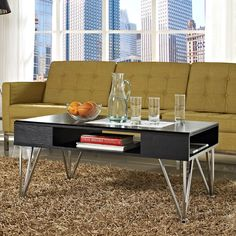 Featuring a gorgeous black finish and chrome hairpin legs, this contemporary oak coffee table serves as a beautiful center piece for your living room. Constructed with plenty of nooks and compartments for your stuff, this table is practical as well.
