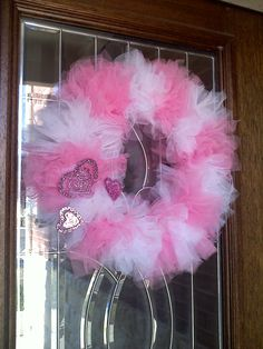 Just finished making this and hanging it on my front door!  Turned out pretty cute!