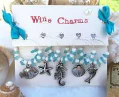 Check out this item in my Etsy shop https://www.etsy.com/listing/259761452/wine-charms-beach-wine-glass-charms-set