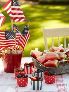 These crafty 4th of July party ideas will help you host a fabulous, patriotic picnic or a Fourth of July gathering nearly anywhere. #fourthofjuly #fourthofjulyideas #fourthofjulyparty #centerpieces #bhg Blue Desserts, 4th Of July Desserts, Fourth Of July Food, 4th Of July Fireworks, July 4th, Cookout Decorations, 4th Of July Decorations, Fruit Holder, 4th Of July Parade