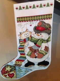 Christmas cross stitched stocking - Purchase at my Etsy Online Final Desitnation Store. Click on stocking image to buy now.  #christmasstocking #santastocking #crossstitchedchristmasstocking #santastocking