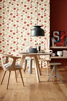 dining room - red color on the walls and warm shades of the wooden furniture; wallpaper