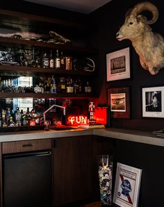 The designer [Benjamin Vandiver] obliged [Kings of Leon drummer] Nathan Followill's request for a lower-level man-cave, furnishing the space with taxidermy, dark woods and, not visible, a shelf for the musician's Grammy awards. Photo by Reid Rolls