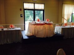 Megan and James' head table with lighting and peach swag! #summerwedding #weddingideas #capriottiscatering #headtable