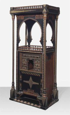 CARLO BUGATTI (1856-1940) A CABINET, CIRCA 1900 ebonized wood, pewter and brass inlay, hammered brass 71 ½ in. (181.6 cm.) high, 32 ¼ in. (82 cm.) wide, 21 3/8 in. (54.4 cm.) deep