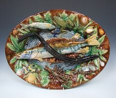 A truly magnificent, very rare and majestically glazed, large and important Palissy platter signed by Francois Goras for the Renoleau factory, smothered in a vibrantly glazed profusion of aquatic flora and fauna. French c1880  Dimensions in Inches: L: 23 ins W: 17 ins