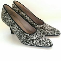 Neiman Marcus Animal Print Pumps Size 8 These Neiman Marcus Animal Print Pumps are a Size 8 in great used condition. They were worn once for a photo shoot inside. The bottoms have no outside/pavement wear to soles or heel caps. There is a mark on one sole where these were marked for the shoot. Made of calf hair and leather, these designer shoes are made in Italy. The calf hair is a slight bit ruffled in two spots, as expected with animal hide. Black suede on the backs/heel area. 3 inch heel…