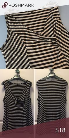 s t r i p e d   t a n k 🎼 Striped tank with paneled/overlapping pleated detail on chest. Flattering multi-directional stripes of grey and black all over. Slight shark bite shaped hem. 48% polyester 48% rayon 4% spandex. Size 1X. Made in the USA 🇺🇸 Check out my closet for more L/XL and 14/16 clothing. Bundles are only two items! Bundle and make a nice deal for yourself or make offer green envelope Tops