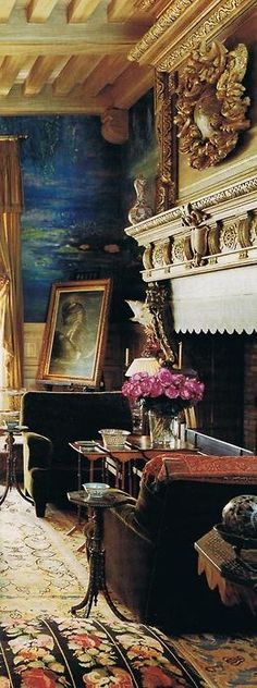 Walls painted in Monet Water Lilies in Ocean Blue. Fire place and wooden beams on the ceiling.