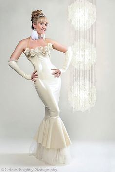 DESCRIPTION:    Stunning and elegant long gown dress with detachable net fishtail and steel boned front. Has alluring ruffle at the top decorated with hundreds of Swarovski crystals. Transparent halter-neck strap to give more support. The back of the dress has a see through transparent panel in a V shape with white trim. Side zip fastening. Colors can be changed to any shade in our latex colour chart.  Shown in the photo in white colour.    Matching gloves sold separately. SIZE:  Available…