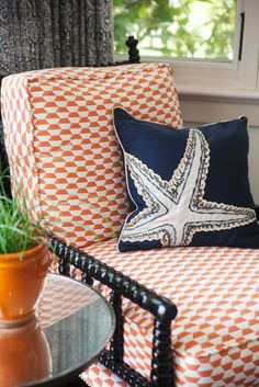Love the orange and blue.  Great chair as well.