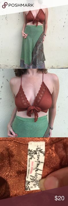 Free PEOPLE top tie boho bralette TANK S/M cropped Super sexy, super boho festival burnt orange brown top that ties in the front. Spaghetti strap back. LACE detailing. 100% viscose. Marked as a XS, but fits a S/M for sure (36 B/C in pictures). N5 Free People Tops