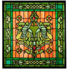 Victorian Flourish window is work of art in this spectacular Meyda Tiffany original. The frame is constructed of Brass as is the hanging brackets and chains included with this window. SPECIFICATIONS: