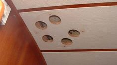 On my boat, the holes in the headliner beneath deck fittings are concealed by…