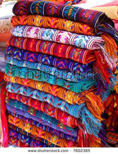 textiles for sale in a market in chiapas, mexico by Jorge R. Gonzalez, via ShutterStock