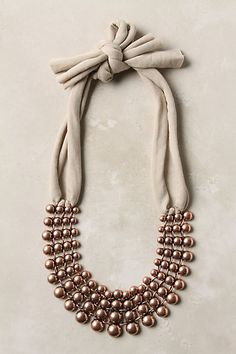 the multi-strand pearls with ribbon thing is proving to be a hot trend this season.  That means that people will buy it in Upstate NY in the spring of 2014.