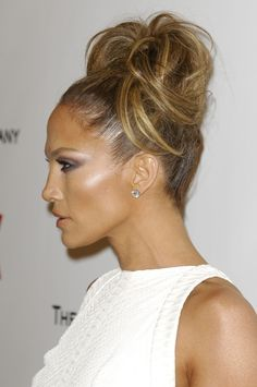 It's two days after the 2015 Golden Globes and I'm still thinking about how fantastic Jennifer Lopez looks. Really, the woman is a national treasure in the beauty department. Her skin is perfect (even at 45 years old), her eyes were made to be smoky, and her hair is always full and lovely. And I have a theory: She may not be real but actually a hologram of a computer-generated vision of perfect from the future. Here are three pictures that support this hypothesis. This shot was from t...