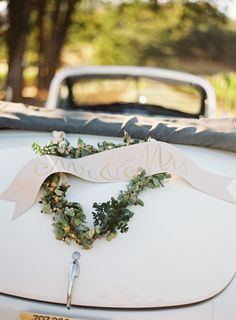 Lovely Mr. & Mrs. decorated getaway car