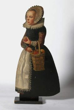 Dummy board from the second half of the 17th century representing a girl with a basket of apples and walnuts, at Chirk Castle, Wrexham. ©National Trust Collections