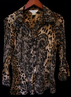 This is a gently worn New York City Design brown black tan casual long sleeve L Women's Top Blouse. This top is in excellent condition. The fabric is very lightweight and has a pleated look. This fabric stretches. This top has a beautiful abstract animal and black lace print. The colors are black tan brown green gray. The sleeves are 3/4 length and bell at the bottom. There are 6 black buttons up the front. This is a very eye catching, stylish garment.