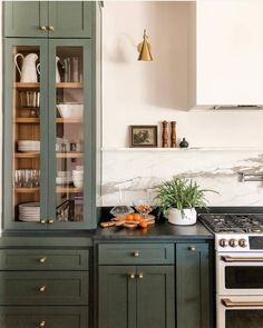 Yay or Nay: Moody Green Interiors – Green cabinets and brass hardware with soapstone counters. – - Yay or Nay: Moody Green Interiors - Green cabinets and brass hardware with soap. Updated Kitchen, New Kitchen, Kitchen Dining, Eclectic Kitchen, Kitchen Ideas, Kitchen Trends, Modern Kitchen Design, Kitchen Layout, Open Shelf Kitchen
