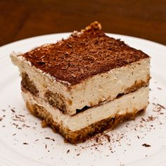 Simple Tiramisu 1 cup(s) heavy whipping cream .5 cup(s) prepared coffee 1 (2 to 3 ounces) double shot espresso 1 pound(s) mascarpone cheese 0.5 cup(s) granulated sugar 3 tablespoon(s) rum or brandy 20 ladyfingers (a light, oblong italian cookie with powdered sugar on one side) Cocoa powder 1 ounce(s) unsweetened dark chocolate shavings, for topping