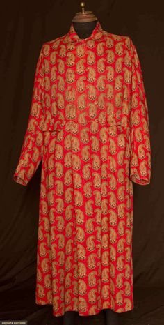 "Cotton print banyan, c1840; Brick red ground printed with green, white, blue and yellow botehs, double breasted with twelve self covered buttons, two front flap side pockets, fitted back, two buttons at low waistline above triple pleat, red cotton lining, CH 48"", L 54""-57"""