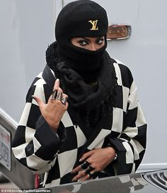 Covered up: Beyonce tried to go incognito in a Louis Vuitton ski mask as she left a studio in LA on Wednesday