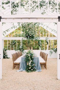 Floor to ceiling floral design in this greenhouse! The table design featured a stunning floral garland centerpiece. Photo: @nicolecolwellphotography Dusty Blue Weddings, Floral Garland, Southern Charm, Your Heart, Wedding Reception, Wedding Ideas, Garden Wedding, Wedding Bouquets, Wedding Gifts