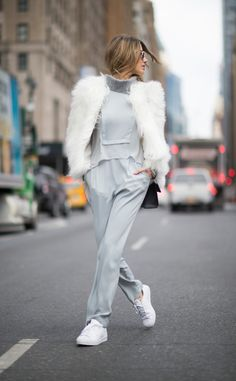 Gray on Gray from Street Style at New York Fashion Week Fall 2016  Martha Graeff looked extra chic in agray jumpsuit and a stark-white jacket on thestreets of Manhattan.