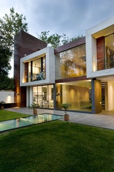 modern architecture - not sure what the glass path is all about - subterranean extension?