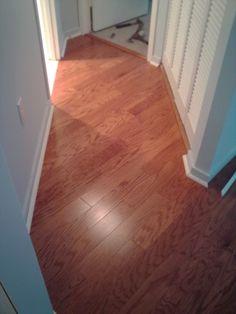 Engineered hardwood flooring- diagonal installation throughout the hallway-