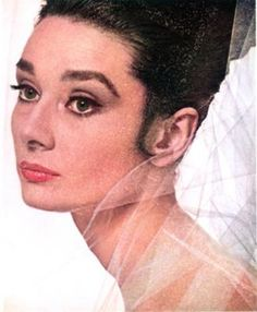 Audrey Hepburn in a Givenchy perfume ad, photographed by Bert Stern