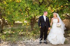 Wedding Photography Pose for bride and groom in orchard l  South Coast Winery Temecula CA l Leah Marie Photography