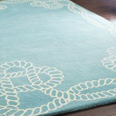 Nautical-inspired hand-tufted wool rug, showcasing a twisting rope motif. @Pascale Lemay De Groof