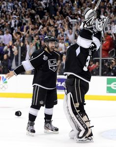 Drew Doughty #8 And Jonathan Quick #32 Of The Los Angeles Kings Celebrate The Kings 6-1 Victory As