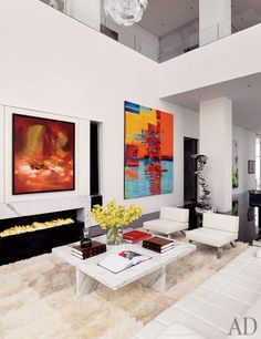 An Asian-Inflected New York Penthouse. Paintings by Chu Teh-Chun (left) and Nola Zirin animate a living room wall; behind the pair of Cassina lounge chairs is a sculpture by Tony Cragg.